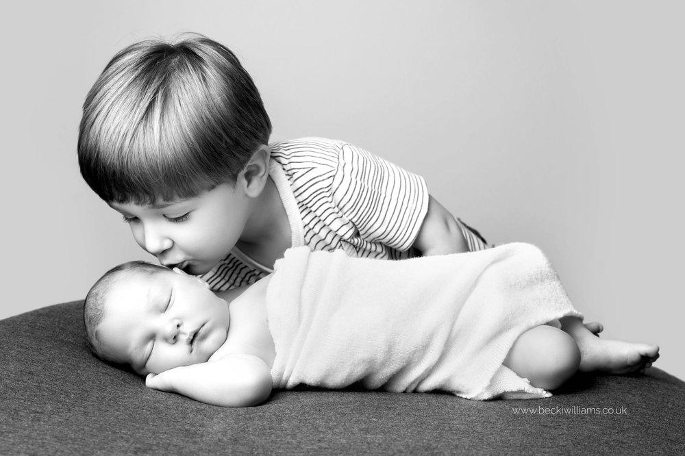 newborn-photographer-in-hertfordshire-boy-cute-asleep-big-brother-family.jpg