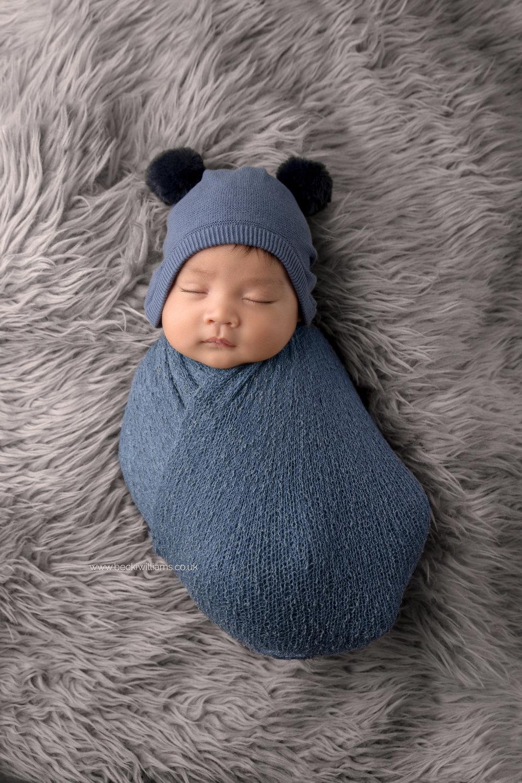 newborn-photography-in-hertfordshire-watford-cute-wrapped-blue-hat.jpg