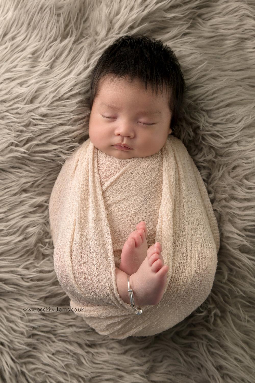 newborn-photography-in-hertfordshire-watford-cream-wrapped-traditional-studio.jpg