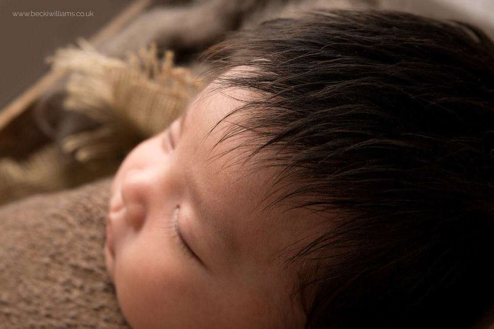 close up photo of a newborn baby's long hair in watford
