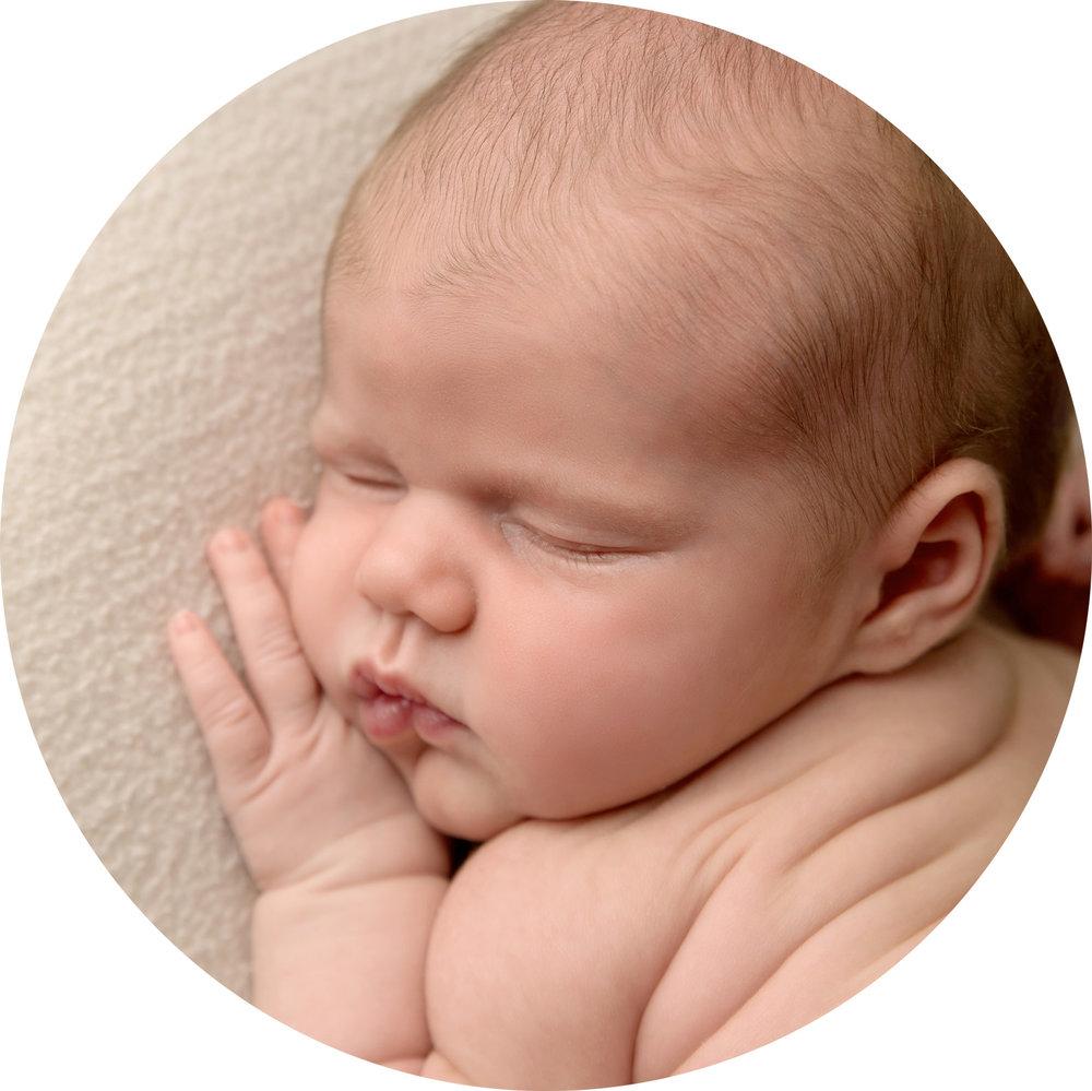 close up photo of newborn baby girls face as she sleeps