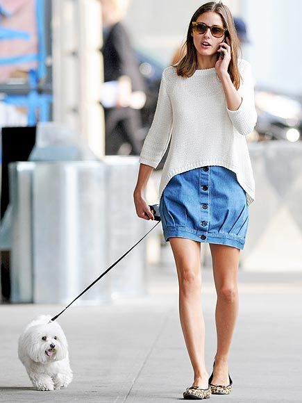 Olivia Palermo in a striped button-down, denim skirt and flats.