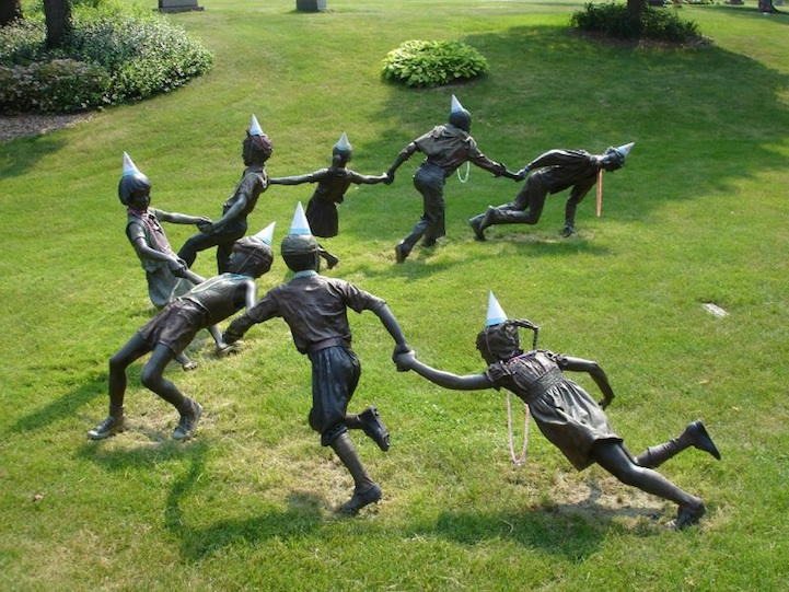 This grouping of sculptures, by J. Seward Johnson, bring back memories of childhood days, and is one of the many focal points in the cemetery. Gets a bit creepy when anonymous puts party hats and beads on them.