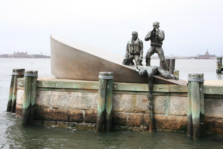 The memorial, designed by artist Marisol, was based on a  true event  during World War II, in which a Nazi U-boat attacked an American merchant marine vessel. While the marines held on to their sinking vessel, the Nazis photographed the victims, then left. The memorial is directly inspired by one of those photographs.