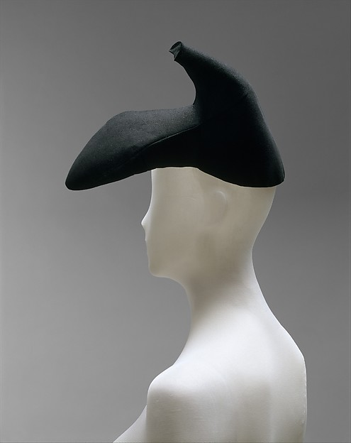 Schiaparelli's collaboration with Salvador Dali reached the height of Surrealist absurdity in this high-heeled shoe from winter, 1937-38. The idea for it, as recounted in Dilys Blum's authoritative book on the designer, was a photograph of Salvador Dali wearing a shoe on his head and another on his shoulder taken by his wife in 1933. The hat was made to wear with a black dress and jacket embroidered with red lips which were suggestive of those belonging to of the voluptuous actress Mae West for whom Schiaparelli was designing movie costumes at the time.