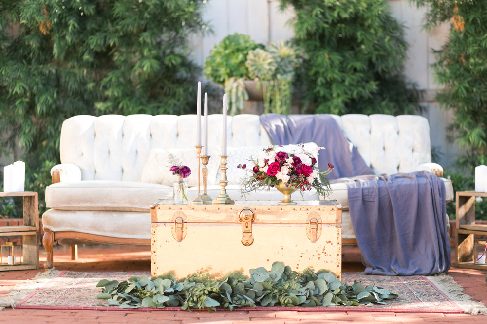 copper and plum modern bohemian wedding rehearsal dinner table design