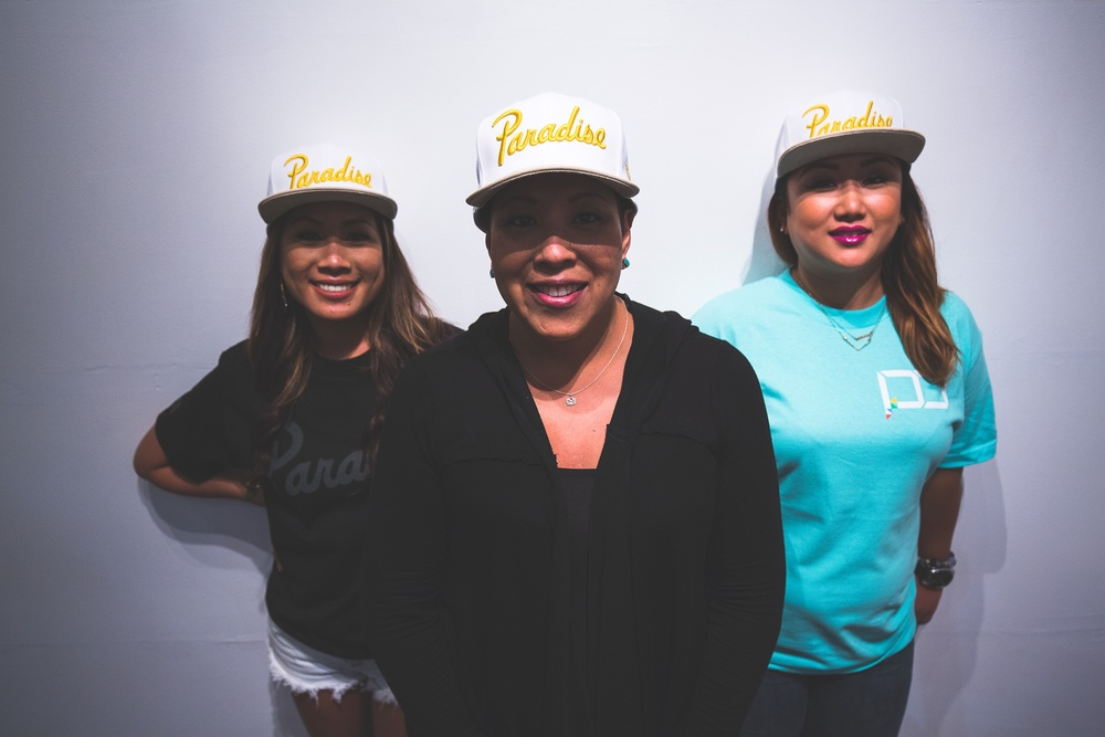 "Releasing today is our Paradise ""The Fight Never Stops"" Snapback. This is a very special project to us due to a close family friend just passed recently from cancer. Proceeds from this hat will be going to help the family with expenses. Here are three strong women on their current battle with cancer. They are the real definition of fighters. Turning frustration into motivation. Cancer can take away all their physical abilities, but it can not touch their minds, it can not touch their heart, and it can not touch their soul.  Kelsey Kandoc, 28. ""After my Stage 4 diagnosis in 2013, doctors estimated I wouldn't live to see July 2014. After the first failed surgery, I wanted to give up and accept cancer as my destiny. Persistent self-talk was key; I converted my frustration into motivation and began my path as a serial entrepreneur. Screw survive. I won't stop until I transcend!""  Alyson Rod, 25. ""In 2001 diagnosed with osteosarcoma, a childhood bone cancer, did surgery and chemo. Been in remission for 13 years and in 2014 was diagnosed again with stage 4 stomach cancer. Did surgery to remove my stomach, and still doing chemo ever since. Cancer may have started the fight, but I will finish it.""  Cheryl Burnett, 47. ""I'm a wife, mother, nurse, and flight attendant. On Sept. 23, 2014 I was diagnosed with stage 2, triple positive, Invasive Ductal Carcinoma of the right breast. I have had 6 rounds of Chemotherapy combined with Biological therapy, each dose 3 weeks apart. I lost all my hair, couldn't eat, therefore lost muscle strength and energy. Then a bilateral Mastectomy with the start of reconstruction. However, because 5 out of 15 lymph nodes removed were still positive at the time of surgery, I had 5 weeks of daily radiation to my chest wall and armpit. This photoshoot was taken 4 days after my completion of radiation. My hair is slowly growing back. My appetite is good, a little too good, LOL! I'm still struggling to gain my strength and energy back. But, I am so happy to be alive, to be able to go back to work and move on with my life! It's not going to be that easy though, there will be changes I need to make. My life will forever be changed. I feel like this is just the beginning of my fight against cancer. I believe that my life and my family, are worth fighting for! I wouldn't have gotten though them treatments without the help from my family and friends! To them I am forever grateful! If you know anyone touched by cancer in anyway send them a quick text message of uplifting and encouragement words. It will make a world of difference, I promise.""  The Fight Never Stops!"