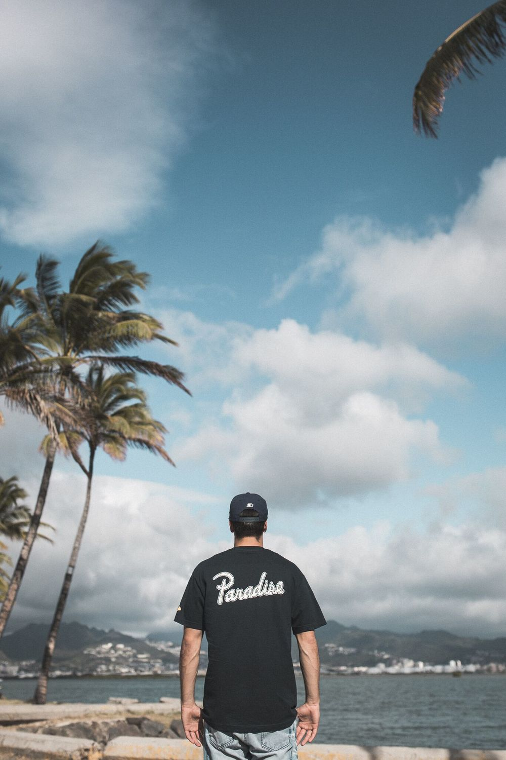 "Bring back the Aloha.  With so much success and anticipation for our ""Hawaiian Airlines"" color way tee we did last year for our Paradise Drive Inter-Island Tour we decided to bring it back but in the OG ""Aloha Airlines"" colorway! The shirt will be available in store and online in black and navy blue."