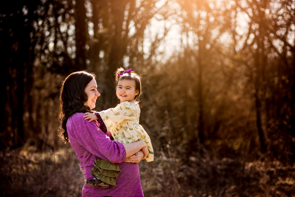 Pregnant woman holds toddler on belly by Huntsville and Madison Alabama maternity photographer Rachel K Photo