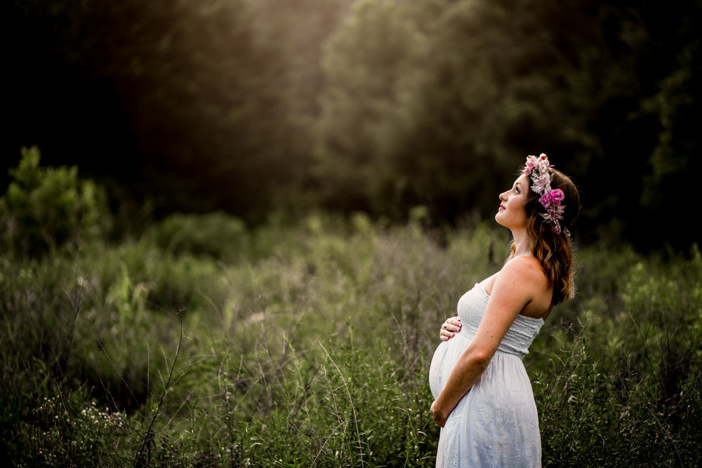 Pregnant woman with white dress and flower crown by Huntsville and Madison Alabama maternity photographer Rachel K Photo