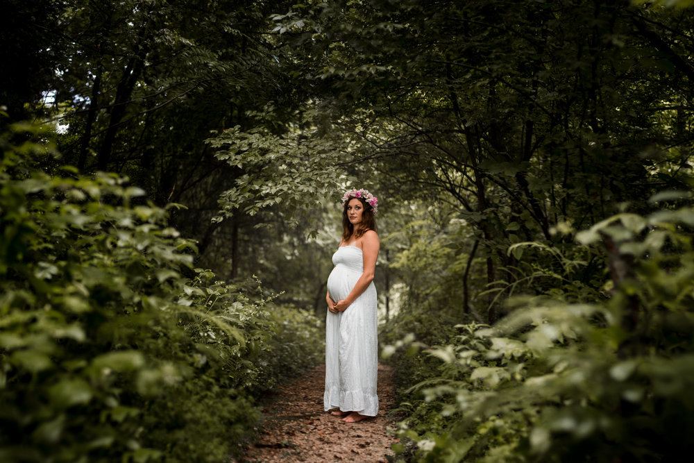 Wooden maternity photo with flower crown by Huntsville and Madison Alabama maternity photographer Rachel K Photo