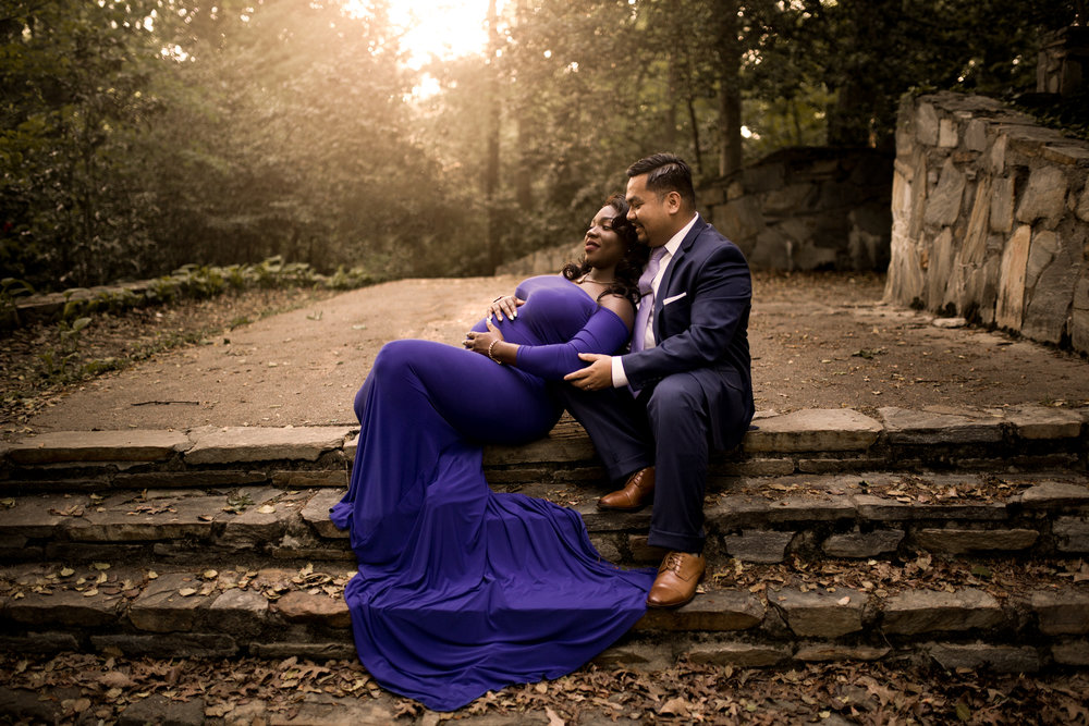pregnant woman in purple dress leans against man on steps by Huntsville and Madison Alabama maternity photographer Rachel K Photo