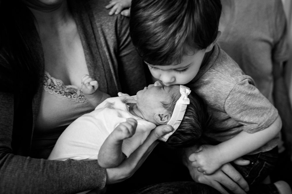 Big brother kisses baby sister from Huntsville Alabama lifestyle newborn session