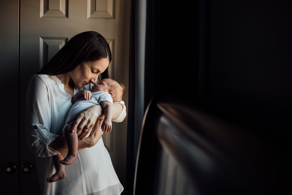 Mom rubs noses with newborn daughter from Huntsville and Madison Alabama lifestyle newborn photographer Rachel K Photo