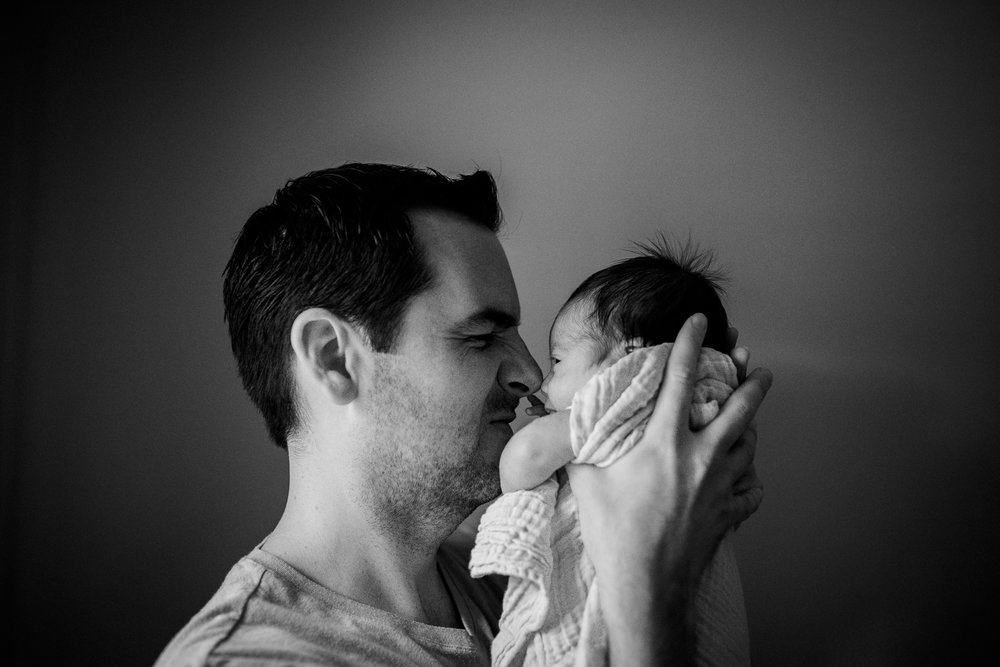 Dad rubs noses with newborn baby from Huntsville and Madison Alabama lifestyle newborn photographer Rachel K Photo