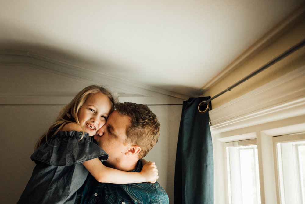 Father snuggles daughter by Madison and Huntsville Alabama family photographer Rachel K Photo