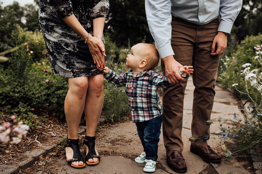 Toddler looks at parents by Madison and Huntsville Alabama family photographer Rachel K Photo