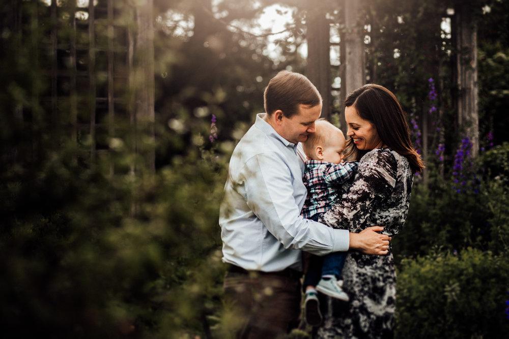 Family snuggles in garden by Madison and Huntsville Alabama family photographer Rachel K Photo