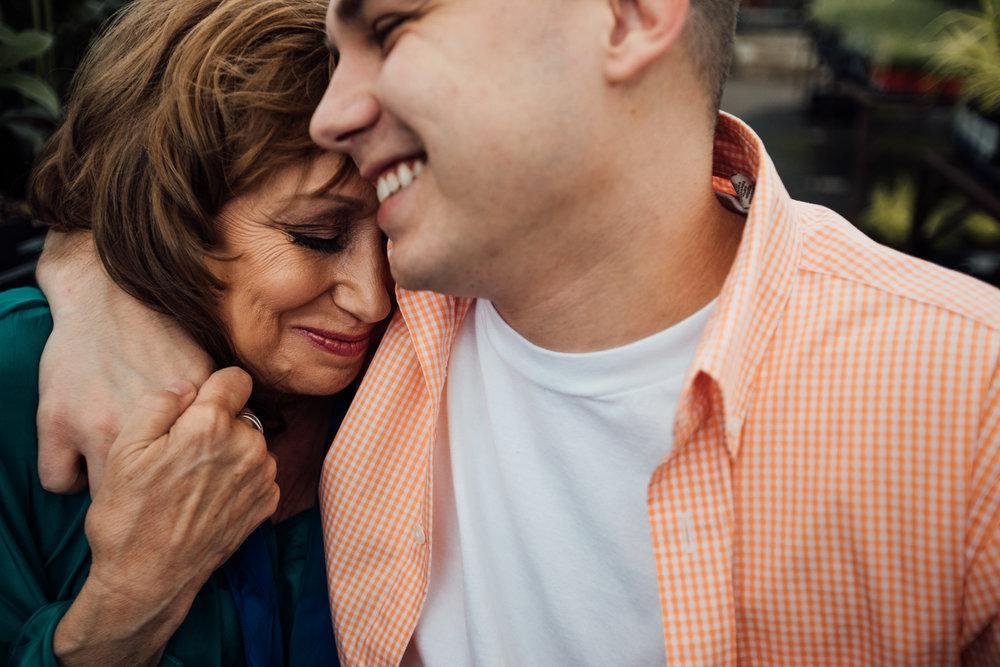 Mom hugs adult son by Madison and Huntsville Alabama family photographer Rachel K Photo