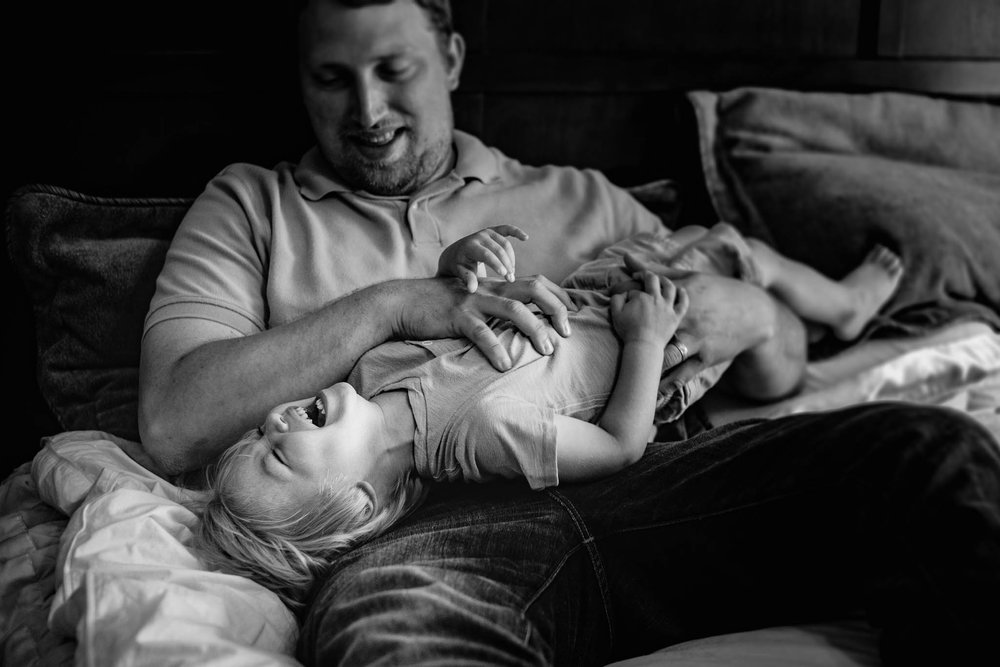 Father tickles son by Madison and Huntsville Alabama family photographer Rachel K Photo