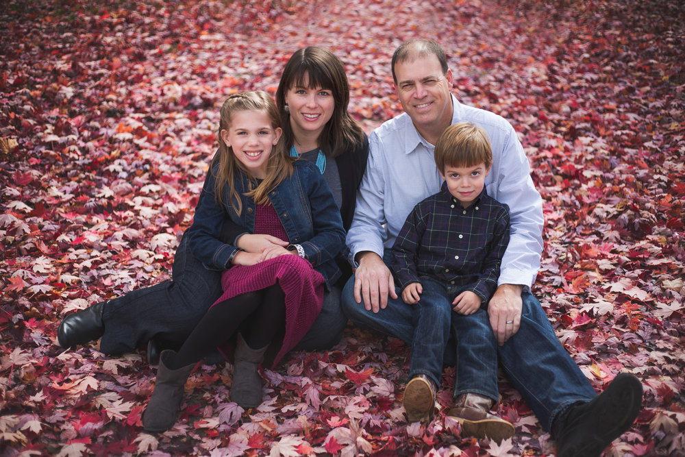 Family of four in red leaves by Madison and Huntsville Alabama family photographer Rachel K Photo