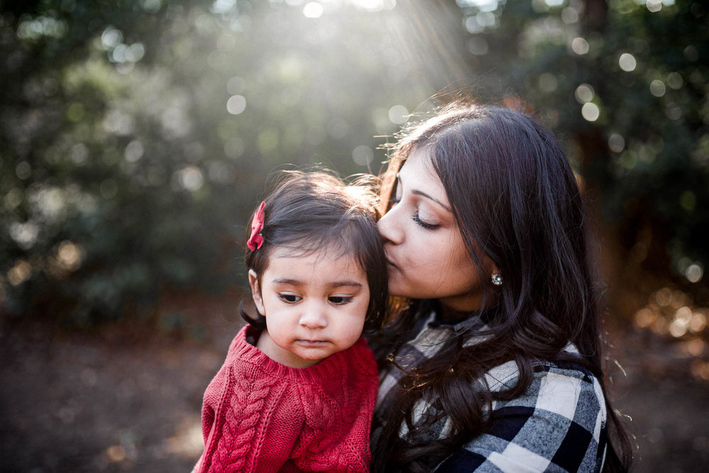 Momma kissing toddler in red sweater by Madison and Huntsville Alabama family photographer Rachel K Photo