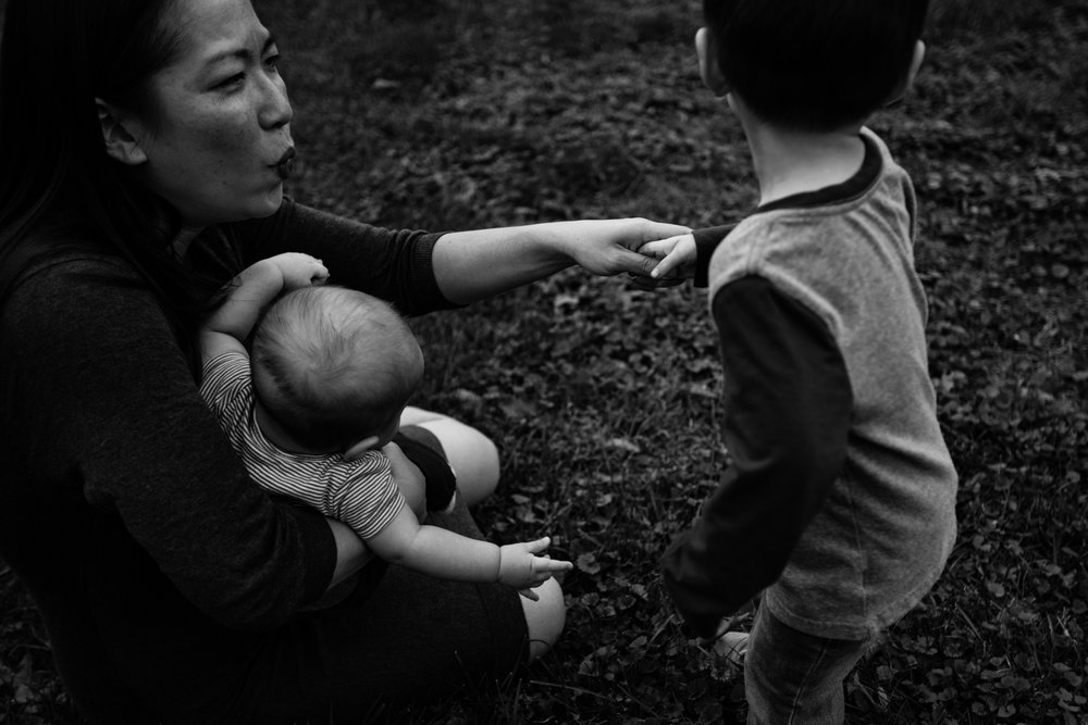 Mother holds son's hand as he tries to run away by Madison and Huntsville Alabama family photographer Rachel K Photo