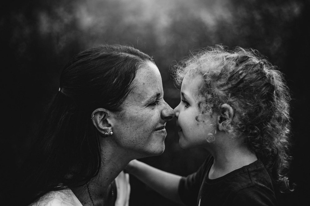 Mother and daughter rub noses by Madison and Huntsville Alabama family photographer Rachel K Photo