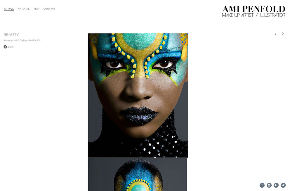 african model with ornate turquoise and blue make-up design