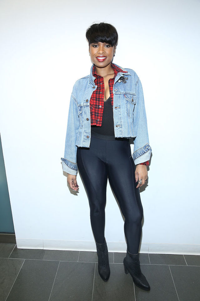 Jennifer Hudson (apple) wearing a deep v-neck that elongates the torso, dark skinnies, and a structured jacket that cuts off at the waist to hide the midsection.