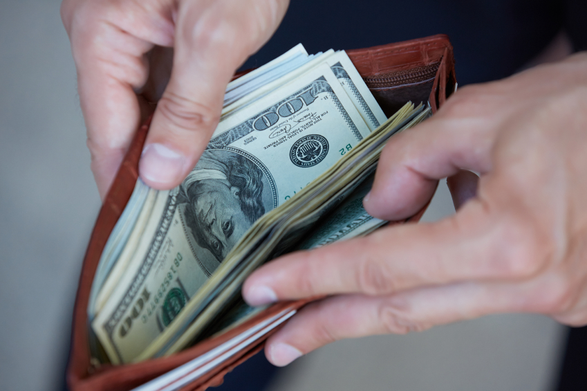 man-holding-a-purse-with-money-closeup.jpg