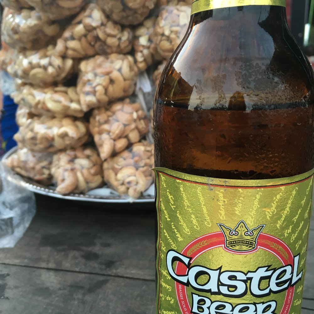 Castel beer and roasted cashews at a buvette in the Stade de l'Amitie in Cotonou. Photo: Marcy O'Neil 2016