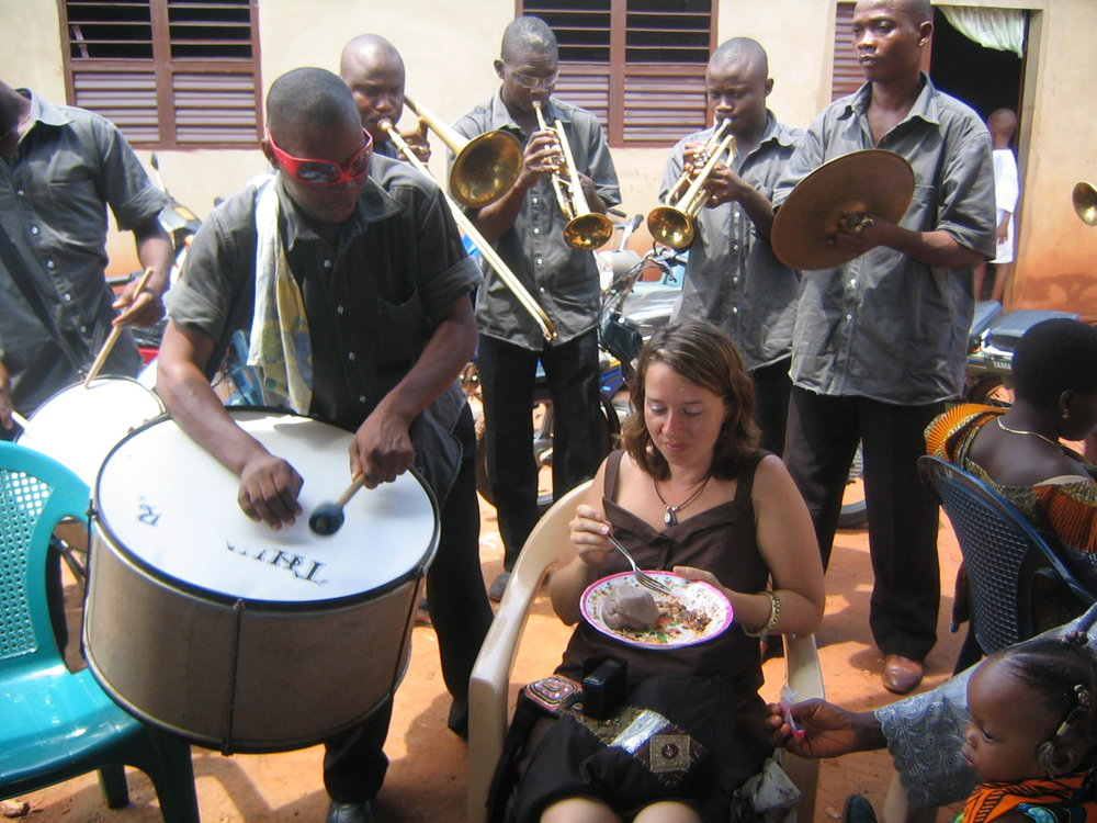 Enjoying a meal of pate noir at a funeral in Abomey in 2008. Bon appetit!