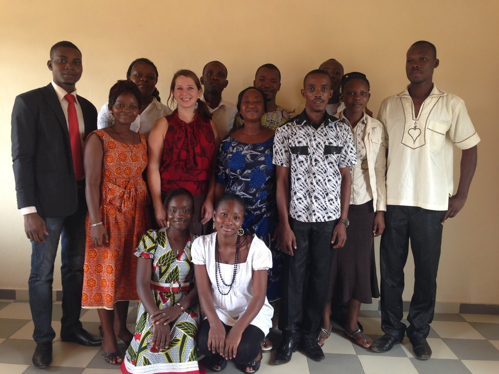 You posted this photo with my crazy hair? Cho! [Photo taken in 2013 with students/alumni of the University of Abomey-Calavi. From left: Venance, Sandrine, Rose, Jocelyne, Marcy, Gratien, Nadège, Sidonie, Yves, Abed-Nego, Cedrick, Geneviève, Paul]