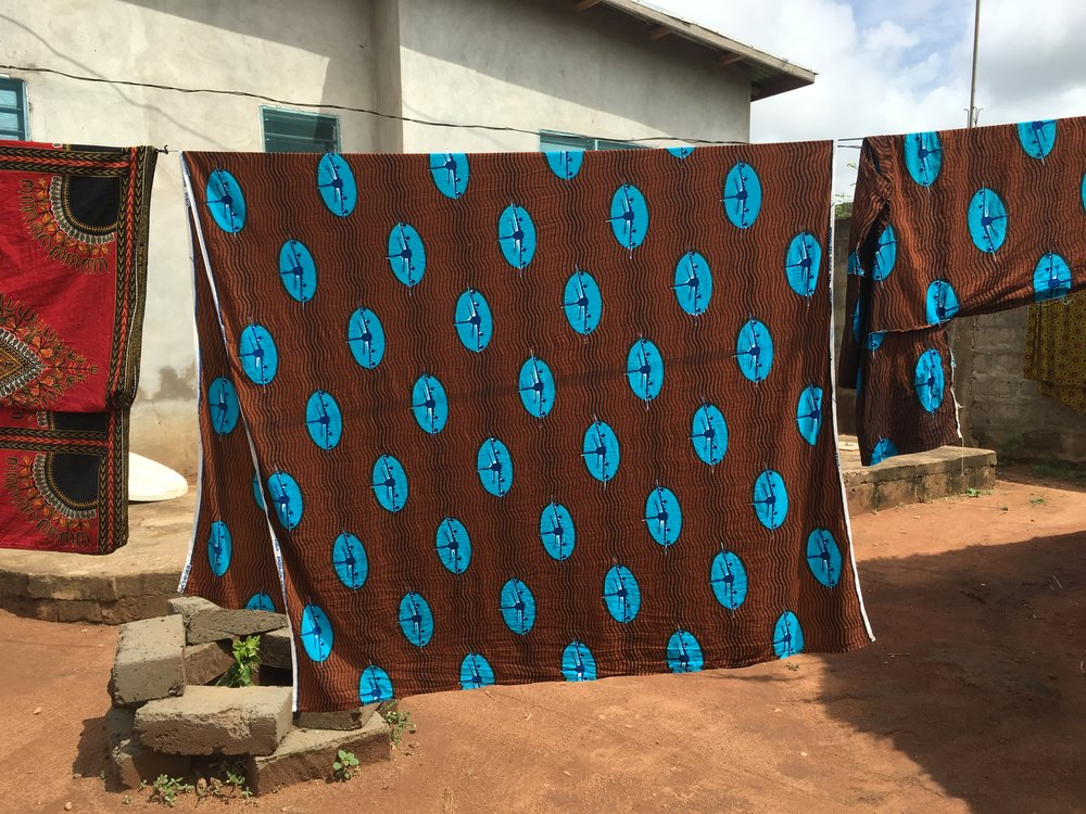 Vlisco cloth designed by Marjan de Groot, hanging out to dry in Agassa-Godomey, Benin.