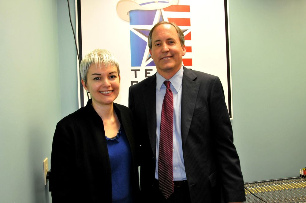 Texas Patriots PAC President Julie Turner with then-Senator Ken Paxton during his campaign for Attorney General.