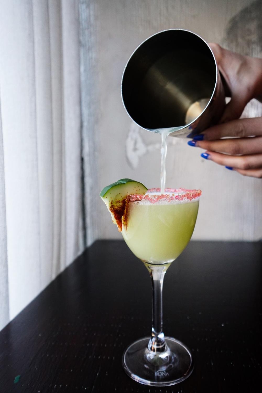 jane danger mixologist pouring cocktail brunch