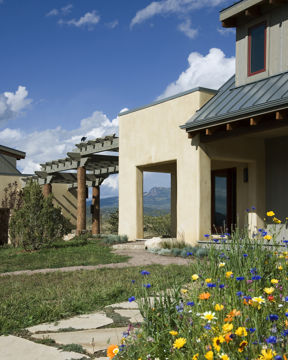 southern_colorado_modern_adobe_porch_flowers.jpg