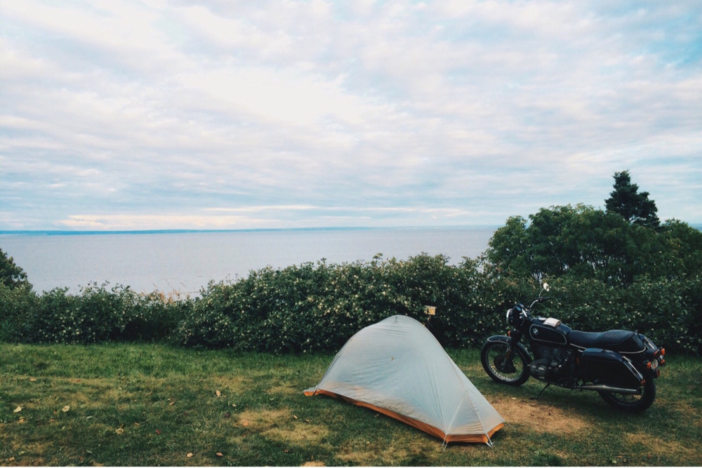 "Camping on the St. Lawrence.   In Yve's words: ""I had a one man tent, sleeping bag & pad. I fit everything for the month in a Chrome Industries waterproof top bag and my 2 Wixom side bags."""