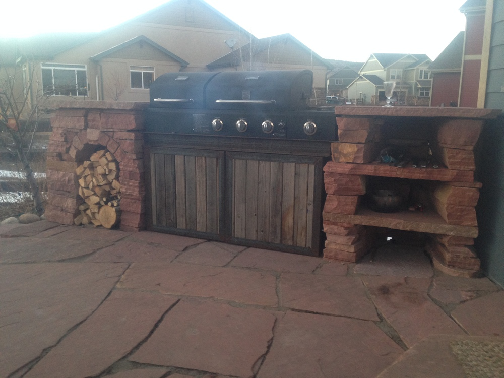 wood outdoor kitchen cabinets this outdoor kitchen in lyons colorado is not made from fake stone and pressure treated plywood with polished sandstone counters smoker barn door wood outdoor kitchens boulder urban oasis