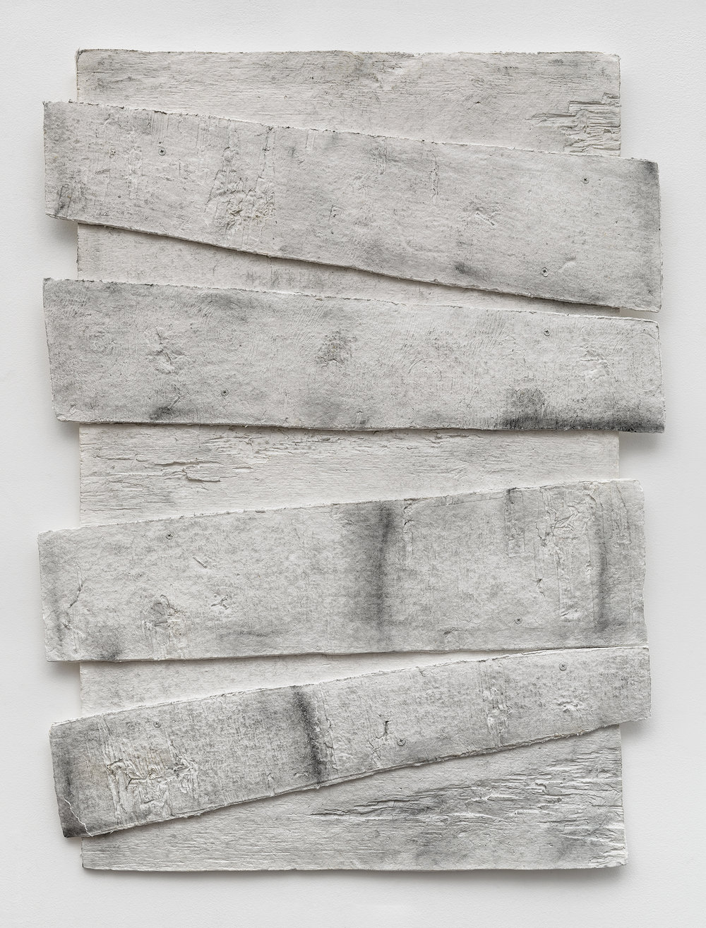 Diana Shpungin   Don't Let The Light In 4 (Stained) , 2018  Graphite, casting cotton paper pulp, linen paper   36 x 46 x 1 inches  Image copyright and courtesy of Etienne Frossard.