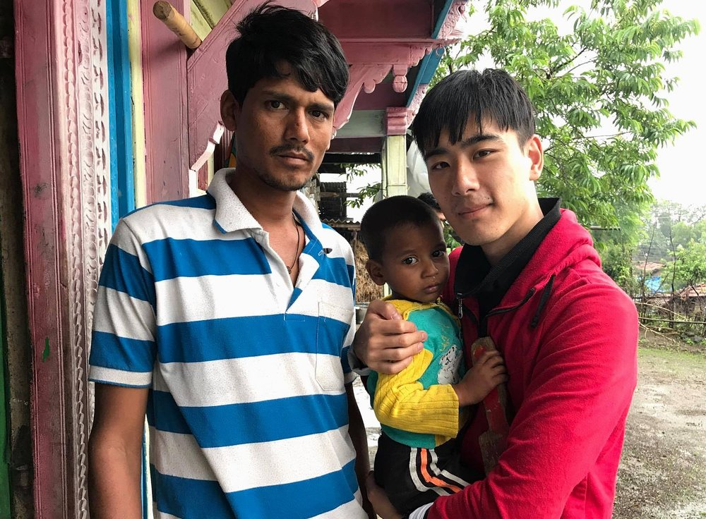 Michael with Sudam and his young son, Abishek