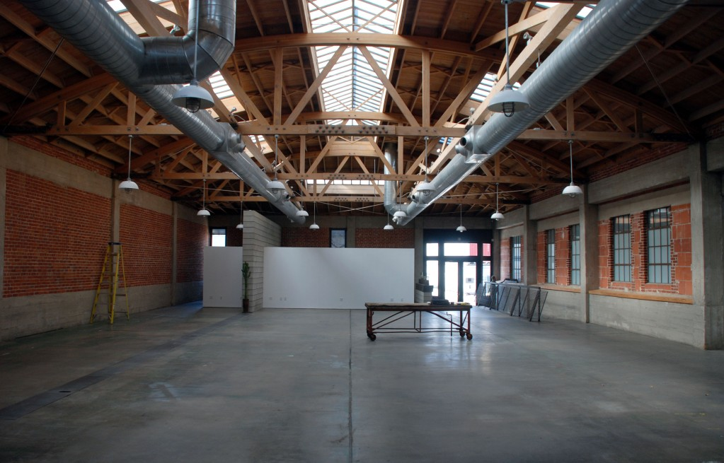 Gallery space in the main warehouse.  A mezzanine level will be built to house studios.