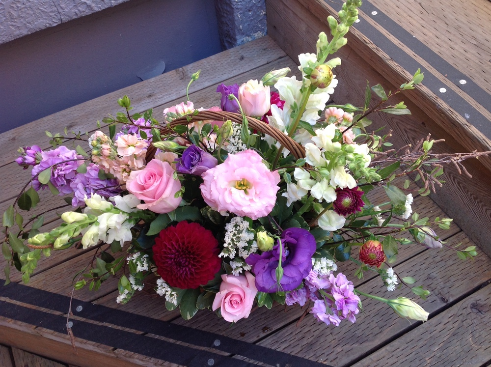 13. Purple and Pink Lush Basket Arrangement