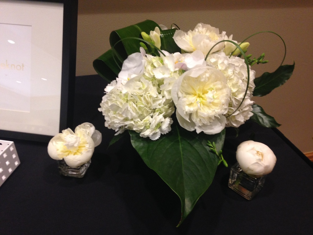 41. Modern White Display with Peonies and Tropical Leaves
