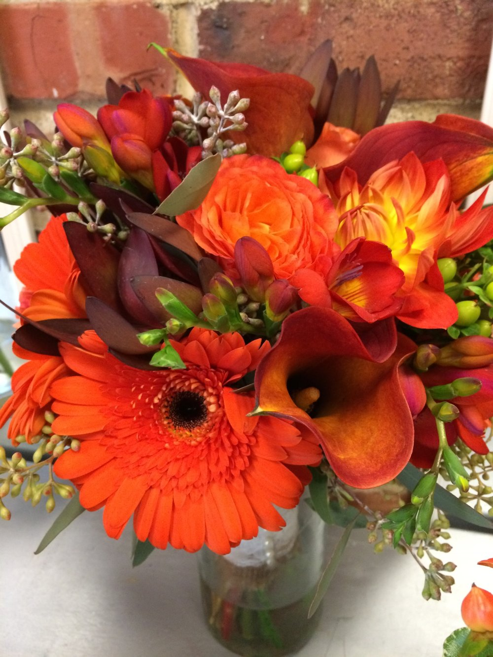 74. Vibrant Summer Bridal Bouquet in Shades of Orange