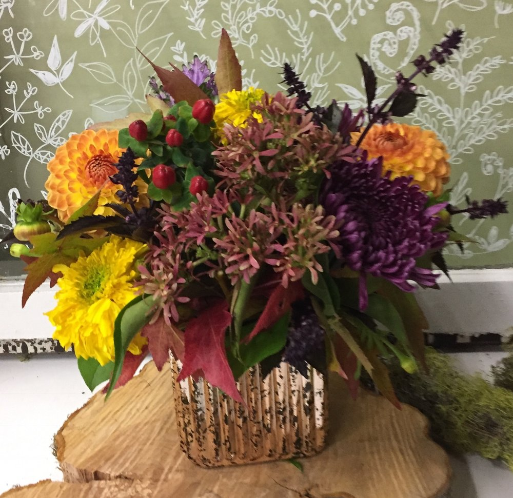 83. Autumn Centerpiece Featuring Pops of Purple