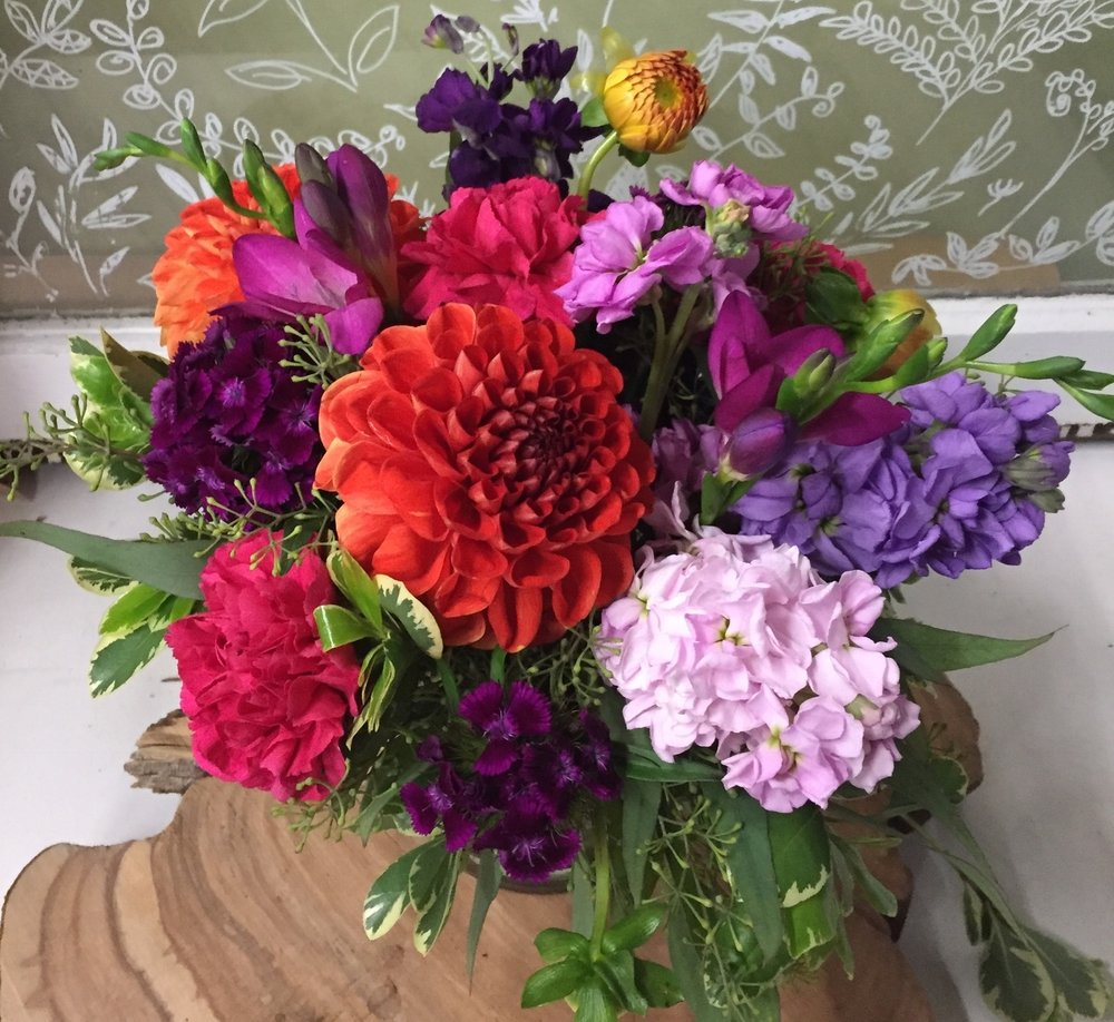 73. Bold and Vibrant Summer Centerpiece