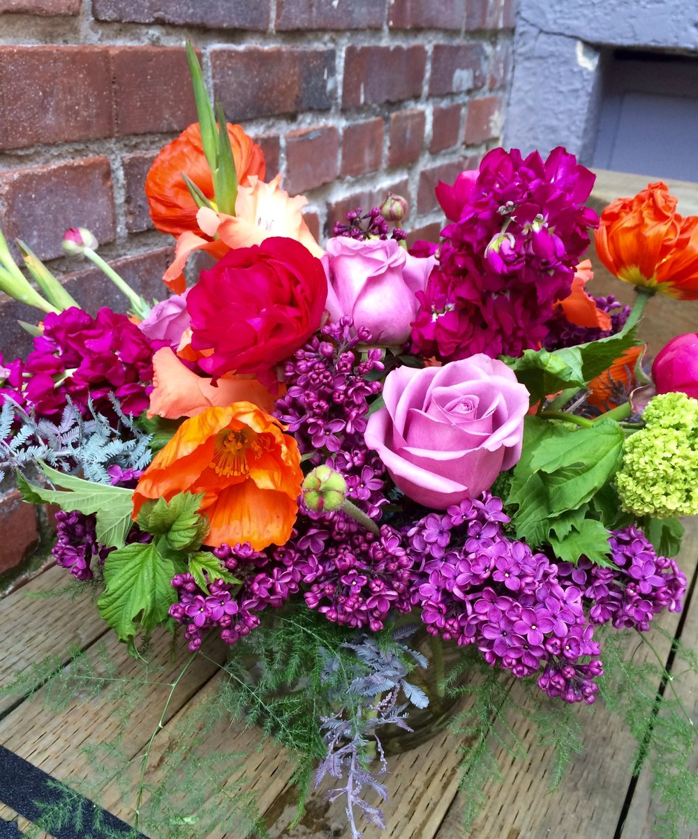 6. Bold and Vibrant with Lilac, Poppies, Viburnum and Ranunculus