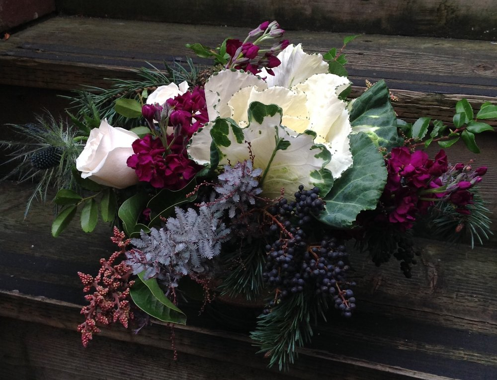 6. Berry-toned Winter Arrangement with Kale